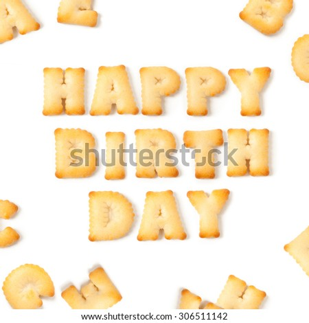 happy birthday message written with homemade biscuits, on white background - stock photo