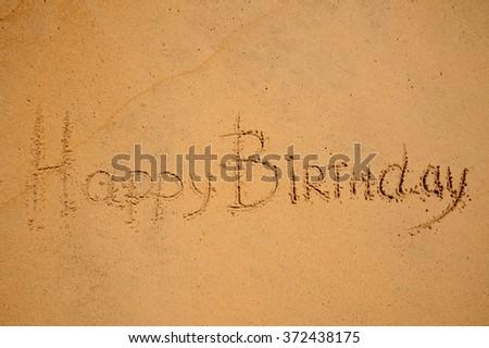 Happy Birthday Sign Written On The Beach