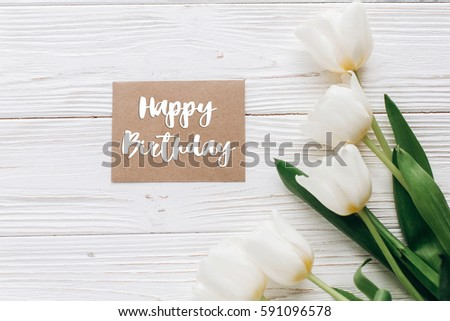 Happy Birthday Text Sign On Stylish Craft Greeting Card And Tulips White Wooden Rustic Background
