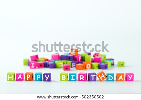 Happy Birthday word spelled with colourful wooden block