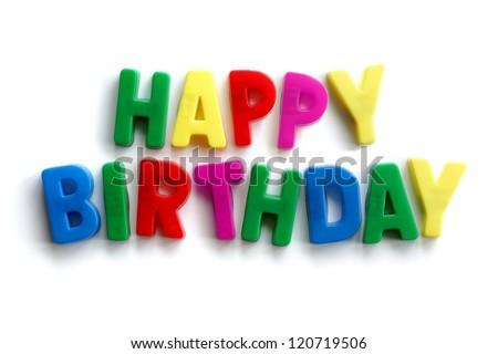 Happy birthday words made from colourful letter magnets on white background