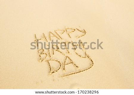 Happy Birthday written on a sand - stock photo