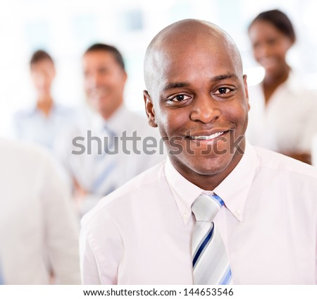 Happy black business man at the office smiling - stock photo