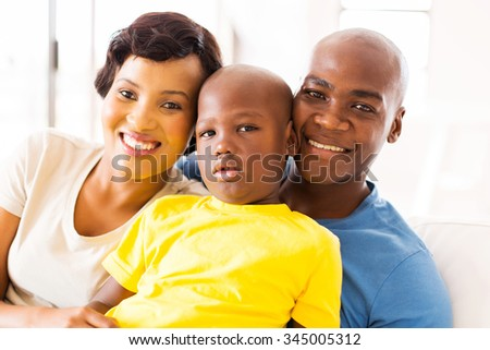 happy black family spending time together at home