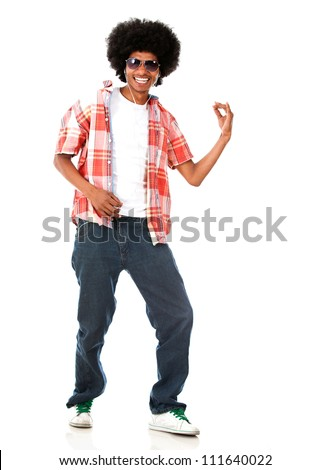Happy black man listening to music - isolated over a white background