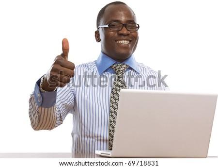 Happy black man with laptop - stock photo