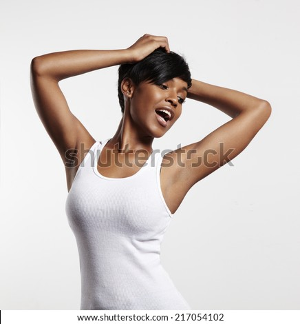 happy black woman in a white top - stock photo