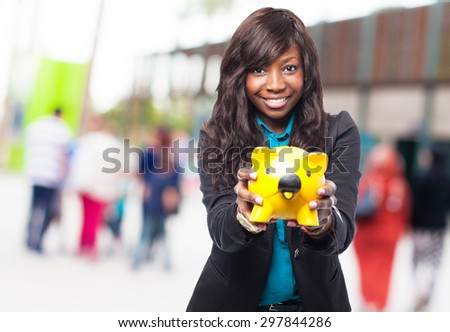 happy black woman with piggy bank - stock photo