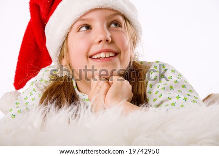 Happy blond girl and her christmas thoughts - stock photo