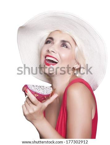 Happy blond girl in a white hat and a red dress holding a ????????. Isolated on a white background. - stock photo
