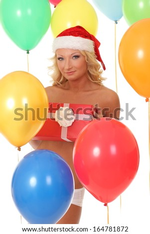 happy blond girl in red Santa hat holding gift box