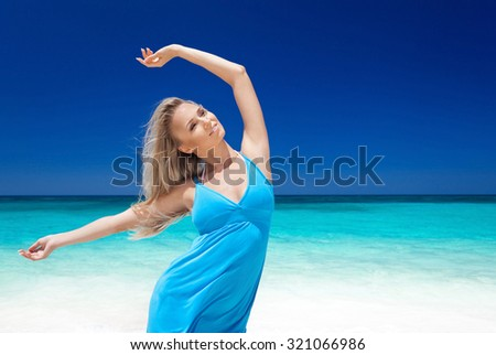 Happy blond girl on beach, feeling freedom and enjoying life. Vacation concept. Free copyspace. - stock photo