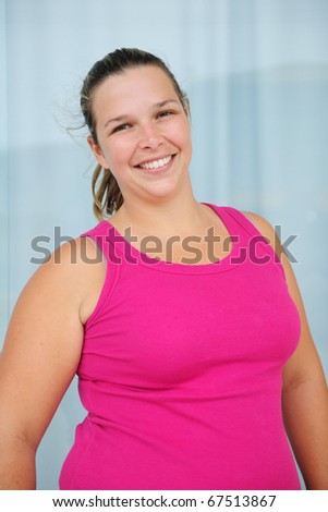 happy blond overweight woman smiling