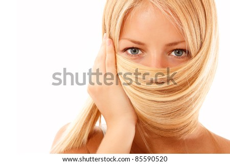happy blond teen girl beautiful cheerful holding her hair isolated on white background - stock photo