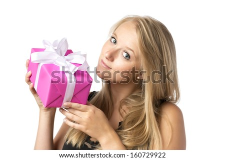 Happy blond woman in black top is holding a christmas or birthday present, isolated on white background