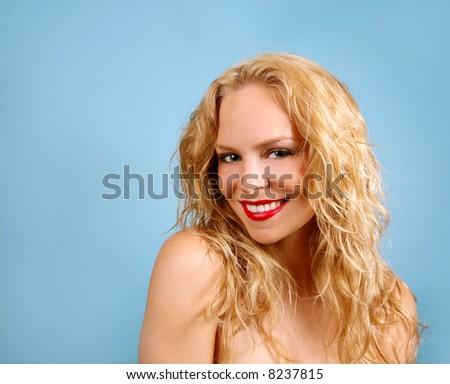 Happy Blonde Female on Turquoise Background - stock photo