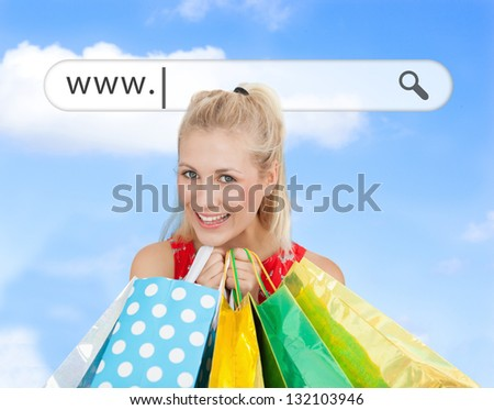 Happy blonde with her shopping bags under address bar on blue sky background - stock photo