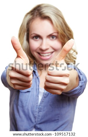 Happy blonde woman holding both of her thumbs up - stock photo