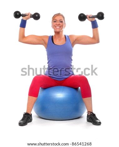 Happy bodybuilder woman exercising and working out with dumbells. - stock photo