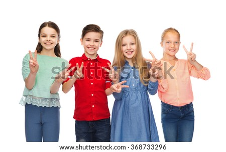 happy boy and girls showing peace hand sign - stock photo