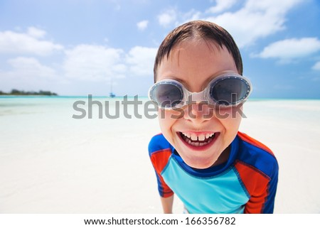 Happy boy at a tropical beach - stock photo