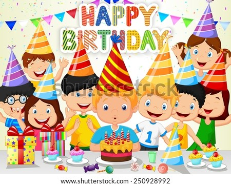 Happy boy blowing birthday candles with his friends - stock photo