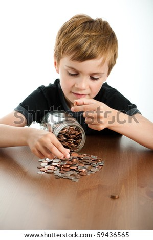Happy Boy Counting Money from Glass Jar