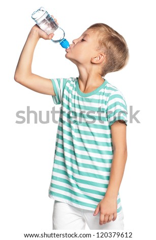 Happy boy drinks water from a bottle isolated on white background - stock photo