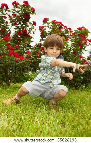 Happy boy enjoy on meadow - stock photo