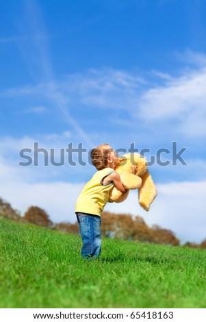 Happy boy enjoy on the meadow - stock photo