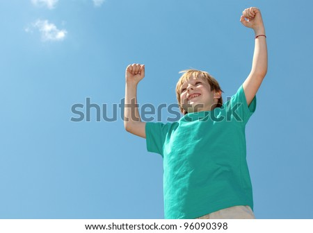 Happy boy football fan on sky background