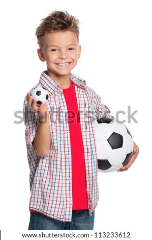 Happy boy holding big and small soccer balls in hand isolated on white background - stock photo