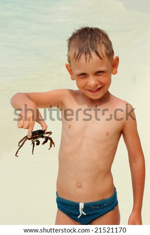 Happy boy holding big crab - stock photo