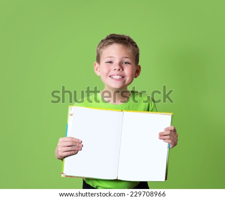 Happy boy holding book with empty copy space. Education concept. - stock photo