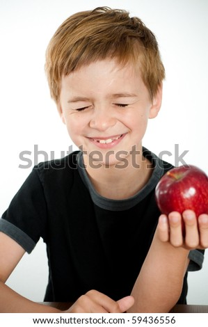 Happy Boy Holding Delicious Red Apple - stock photo
