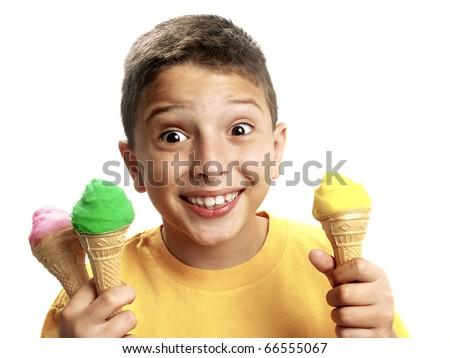 Happy boy holding three ice cream cones. - stock photo