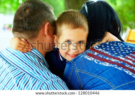 happy boy hugging parents - stock photo