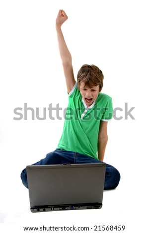 happy boy in front of computer - stock photo