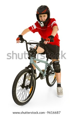 Happy boy in helmet on BMX and looking at camera. Isolated on white background. - stock photo