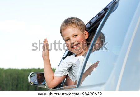 happy boy in the car - stock photo