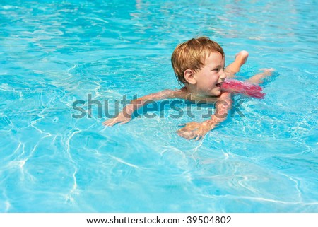 happy boy in waterpool