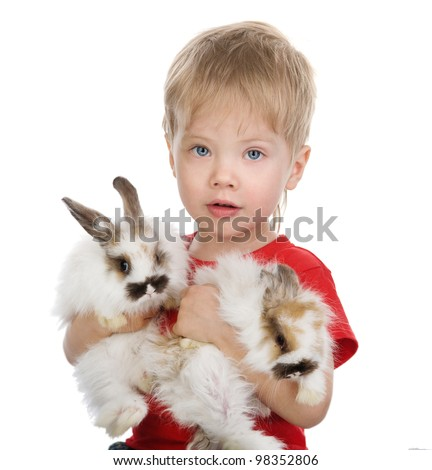 Happy boy is holding a two rabbits. isolated on white background - stock photo