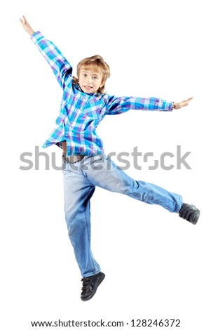 Happy boy is jumping for joy at studio. Isolated over white. - stock photo