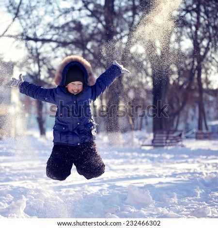 happy boy jump outdoors - stock photo