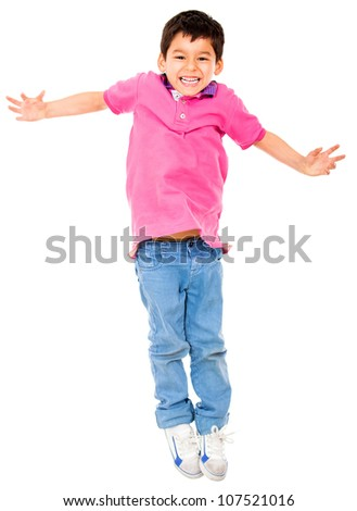 Happy boy jumping - isolated over a white background - stock photo