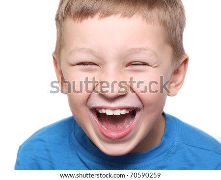 Happy boy laughing with milk mustache isolated. - stock photo