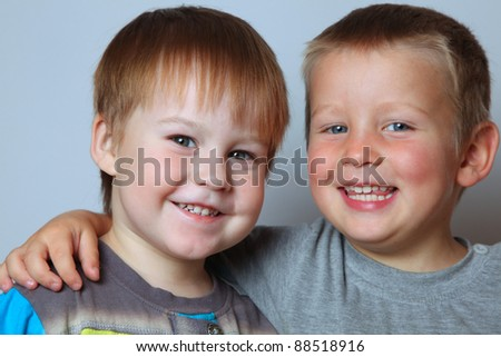 happy boy laughs and shows teeth - stock photo