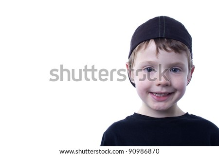 Happy boy looking at camera.  Seamless background.  Room for copy. - stock photo