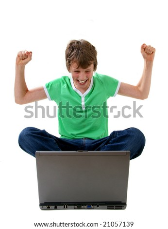 Happy boy looking at laptop computer - stock photo