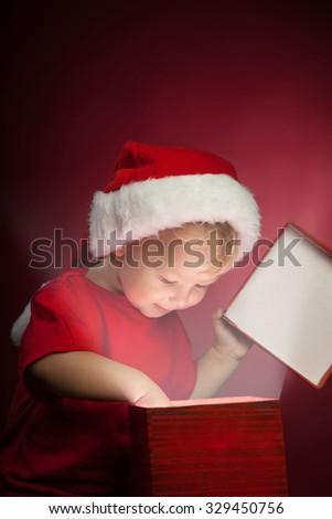 happy boy open christmas gift-box - stock photo